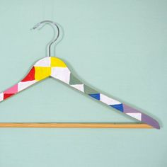 Add a pop of color to your closet with these painted wooden hangers!