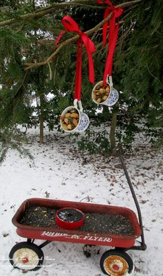 Wagon and Teacup Birdfeeders ~ Use What You Have!   http://ourfairfieldhomeandgarden.com/birdfeeders-use-what-you-have/