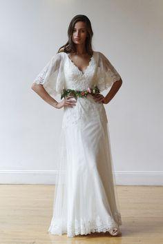 V-neck wedding dress with flutter sleeves and lace details by @davidsbridal | Bridal Market Fall 2016
