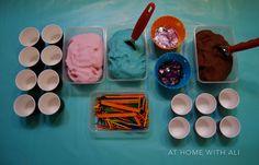 Setting up a playdough ice cream shop with three 'flavours' of playdough ice cream.