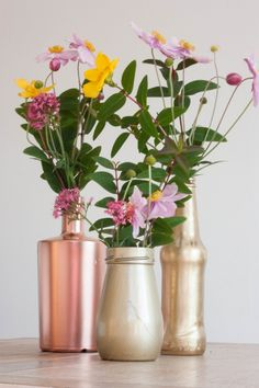 It was our wedding reception on Friday night, so I can now share this little DIY tutorial with you this afternoon. Rust-Oleum kindly offered to send me some of their fabulous spray paints and I have been eager to try them out. So we decided to arrange our blooms in collected jars, tins and bottles painted in copper and gold. Here's how to recreate the look, it's so easy and very friendly on the budget.  What You Need    An assortment of vessels. With labels removed (soak in hot soapy…