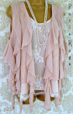 I wonder if I could make a top like this; love the fact that the ruffles are vertical.