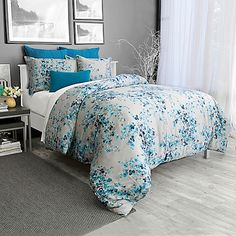 Dress your bed in the blooming Hycroft Duvet Cover Set for a dainty and delicate look in any room. Adorned with an embroidered flower bloom design in Maya blue on a charcoal background, the beautiful bedding brings a serene atmosphere to your bedroom.