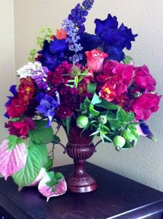 Blue & purple floral centerpiece by Woodland Flowers