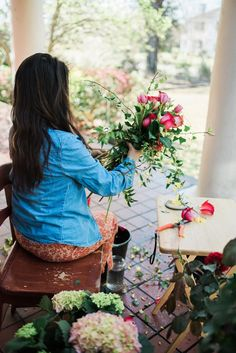 Mayumi designing a stunning rose and tulip bouquet