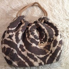 Michael Kors purse. Super cute, very roomy. Was my favorite bag for a long time. Has a cool hidden pocket on the side. Some wear on outside but nothing bad, some little stains on the inside, things you would expect from a used purse. Good condition. Michael Kors Bags Shoulder Bags