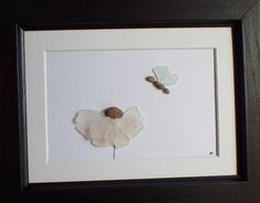 This mosaic sea glass art picture is just beautiful. The flower has a 3D effect, like its coming off the paper at you. Its a perfect, just because gift, or something to give someone who may be struggling, such as a recent divorcee. I created this piece of art using 10 pieces of white sea