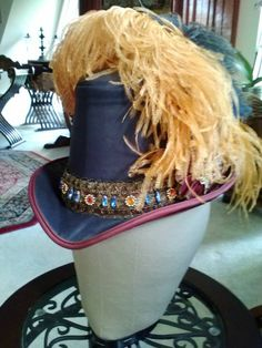 Leather and silk man's Elizabethan tall hat.