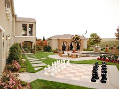Landscaping With Room For Playing. A giant chess board is the highlight of this backyard.