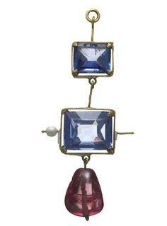 Gold and enamel pendant set with two sapphires and an irregular polished spinel. Photo Credit: Museum of London