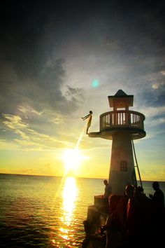 Negril, Negril, Jamaica - Young boys do remarkable dives off this lookout to earn money.