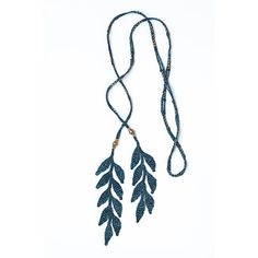 Handmade Ethiopian beads are crocheted with lustrous, hand-painted silk yarn and steam-finished to create the luxurious draping quality of the leaf necklace.
