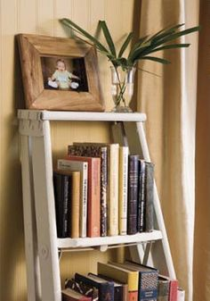 old wooden ladder bookshelf in our bedroom. The ladder was $4 at Get Ted a new ladder