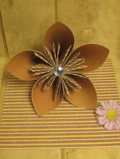 Super easy Super pretty 3d flowers. Great for weddings. DIY instructions included.