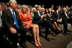 Britain's Home Secretary Theresa May (2nd L) speaks with Defence Secretary Michael Fallon