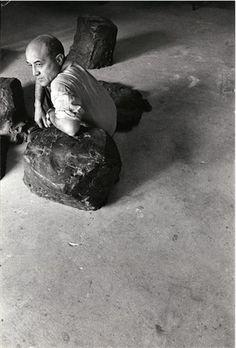 Isamu Noguchi, Isamu Noguchi sitting with his sculpture installation, Lessons from Musokokushi, 1966.Photo by Niki Ekstrom on ArtStack #isamu-noguchi #art
