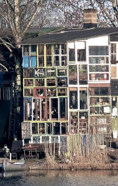 house made of reclaimed windows, Christiania, Denmark. (very cool, but I hope it's not in an area prone to hailstorms!)