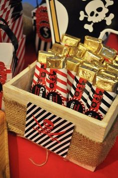 Like the idea of party favors decorated as gold or 'loot' and kept in a pirate chest ... goodie bags with 'gold' chocolate coins, ring pops, Hershey's gold nuggets, beaded necklaces, etc.