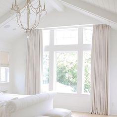 Coastal style bedroom, neutral bedroom, tufted headboard, vaulted ceiling, chandelier, shiplap , hamptons style. white bedroom