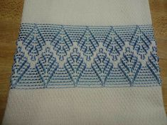 This white huck towel is 14 x Its stitched with light blue pearl cotton. Swedish weaving or huck weaving was popular back in the and It was done on huck fabric which is cotton. The right side of the fabric has a pattern of double loops of thread called Ribbon Embroidery, Embroidery Stitches, Embroidery Patterns, Machine Embroidery, Cross Stitches, Broderie Bargello, Huck Towels, Swedish Weaving Patterns, Swedish Embroidery