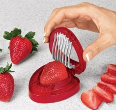 Strawberry Slicer: Most Useless Kitchen Gadget Yet?  I say no way!  If you have a mom or grandma who has problems with arthritis, this is a great solution.  It is also a good way for kids to help in the kitchen.  And I won't lie - it is fun to use no matter how old you are:)