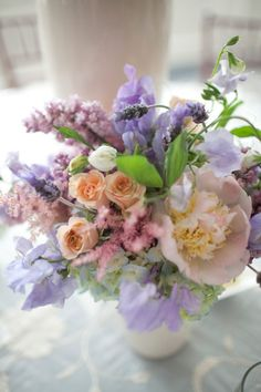 No color stands out. All of the colors are in a harmony. I love the combination of purple and peach.