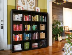 Books arranged by color is what really gives pizazz to this Living Room with it's IKEA EXPEDIT shelving.