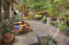 Image from http://images.landscapingnetwork.com/pictures/images/636x510Max/backyard-landscaping_1/rustic-garden-container-plantings-garden-decor-adirondack-chairs-flagstone-water-feature-gregg-and-ellis-landscape-designs_3921.jpg.
