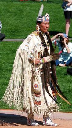 Womens traditional dancer.  Dress is made of buckskin.  Imagine how hot