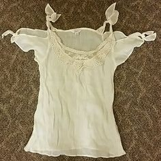 Drapey short sleeve shirt Candies size XS that ties on the shoulder and the sleeves also have little ties. It has embroidery on the neckline. In super good condition. Its just a little too tight on me! No stains or anything and super stylish. Cute with jeans and cowboy boots :) Candie's Tops Blouses