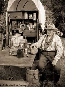Old timer American cowboy, sitting by his covered wagon with a canteen in hand. Old timer American cowboy, sitting by his covered wagon with a canteen in hand. Western Art, Western Cowboy, Vintage Photographs, Vintage Photos, Old West Photos, Old Wagons, Covered Wagon, Chuck Wagon, American Frontier