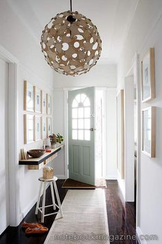 Free standing shelf in entry/foyer. I also like the round chandelier.