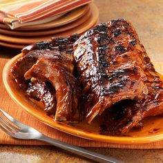 Priceless BBQ Ribs Recipe -The combination of seasonings and a mouth-watering barbecue sauce makes these ribs unforgettable. —Edgar Wright, New Orleans, Louisiana