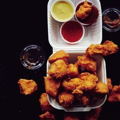 This chicken nuggets recipe is the reinvention of the McNugget, featuring chunks of chicken breast, a marinade of yogurt and hot sauce, a rice flour batter for extra crunch, and three must-have sauces.