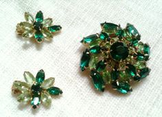 This is a Fantastic Vintage set of Jewels! Beautiful Emerald Green Rhinestones and Light Green Rhinestones in a Sunburst Flower Design make up this Regal Brooch and Matching Earring Set. The Light Green Rhinestones are set with Hollow Backings to Show Bright Color and Shimmer.     Put This Sweet Set on and Feel Like a Hollywood Celebrity of Yesteryear!    All Pieces are in Excellent Vintage Condition. Earrings are Clip on.