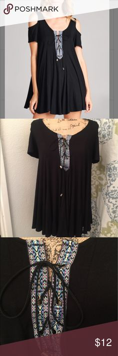 Cold shoulder black tunic Worn 1 time! Like new condition! Super cute and very comfy! Features a lace up front with a colorful thread design. Looks very cute with leggings or tights! (Made in 🇺🇸) EMERALD Tops Tunics