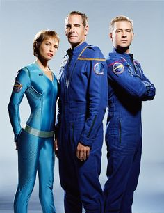 "Jolene Blalock as T'Pol, Scott Bakula as Captain Jonathan Archer, and Connor Trinneer as Charles ""Trip"" Tucker III"