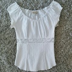 Fashion magazine top with lace middle Super cute white top with lace middle and zipper on one side, fabric is stretchy. Only worn a couple times still like new. Tops