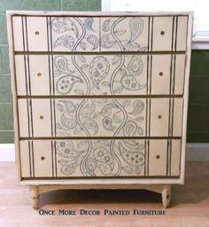 A beautiful dresser finished in Old Ochre Chalk Paint® decorative paint by Annie Sloan, Napoleonic Blue accents and paisley designs | By Once More Decor Painted Furniture