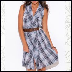 """Plaid Ruffled Shirtdress Ruffled Plaid Shirtdress- a cute breezy cotton gray/navy plaid Shirtdress with cut out details in the back. The fabric is somewhat gauzy but not see-through. 100% cotton. Model is 5' 9"""", chest 32C, Waist 25"""", Hips 35"""" and is wearing a size Small. Boutique Dresses"""