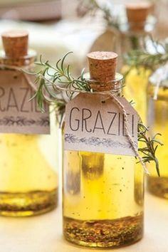 Olive oil infused with herbs. Add a homemade tag and a sprig of rosemary for a perfect DIY gift or wedding favor.