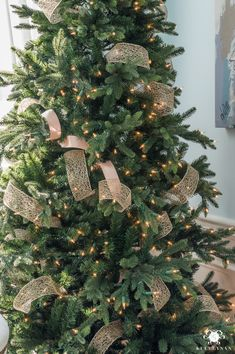 how to add ribbon to a christmas tree pinterest illusions christmas tree and natural