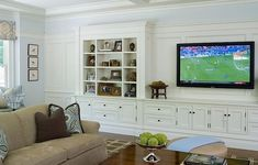 love this wall of built in cabinetry and wainscoting. - would be nice on the hall/living room wall.
