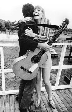 Leonard Cohen and Joni Mitchell at the Newport Folk Festival in 1967 www.fairfieldauction.com