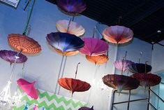 For the Cirque du Soleil-style holiday party for Traffic Control Services, held at its corporate office in Hummelstown, Pennsylvania, in December 2014, JDK Group used eccentric elements like colorful hanging parasols and inflatable furniture by Cort Event Furnishings to transform the room.  Photo: Samuel Costello Photography
