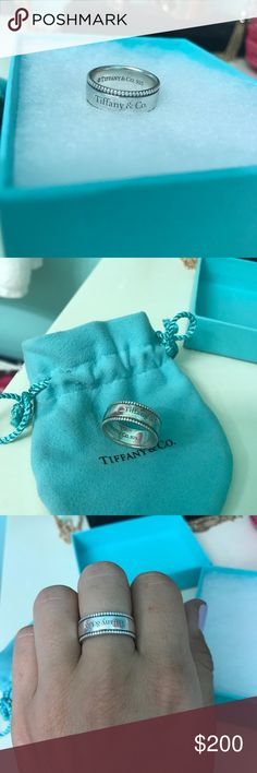 Tiffany & Co silver ring 100% Authentic Normal wearing looking to sell no trades. Comes with Tiffany & Co baby blue jewelry bag and box. Size 8 Tiffany & Co. Jewelry Rings
