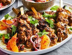 Karen whips up succulent spicy chicken skewers with a sweet and fragrant salad. High on taste, low on effort; this is the perfect summer dish for family and friends.