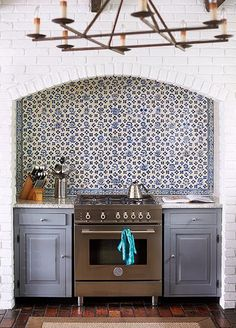 blue and white vintage floral Delft tile backsplash in a renovated ...