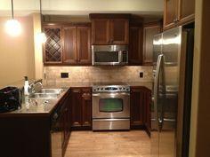 {Kitchen} The total look: Restain dark cabinets, Stainless steel appliances, add backsplash
