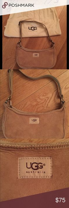 "Ugg Australia Handbag! Authentic Ugg Australia Handbag — Must-Have for Winter! -Made of their iconic sheepskin—suede on the outside, fuzzy on the inside to protect all of your personal belongings  -Sand Color  -Adjustable shoulder strap -Metal hardware and buckles stamped with Ugg  -Ugg patch at front  -Top zip closure  -Comes with dust bag  -Great condition—I've only carried it a few times and have always stored it in its dust bag  6"" tall x 9.5"" wide x 3"" deep (approximately) UGG Bags…"